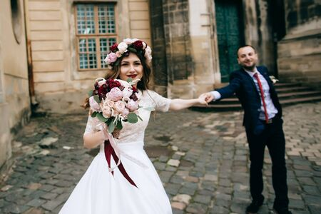Happy bride and groom on the streets of the old city