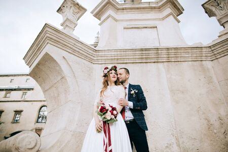 bride and groom celebrating their marriage on the old city in Europe. wedding concept Standard-Bild