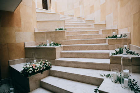 Rustic wedding decor, decorated stairs white candles and fresh flowers
