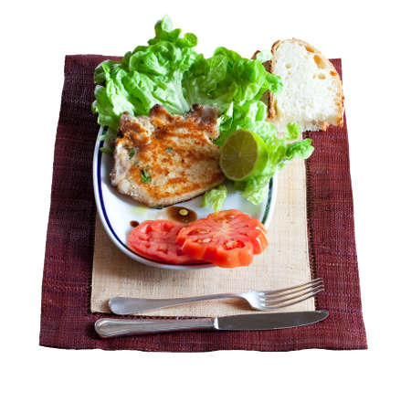 Breaded steak and salad photo