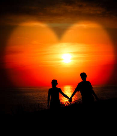 Lovers at sunset Stock Photo