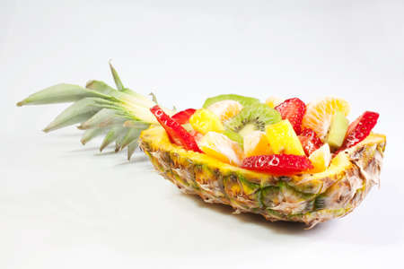 Fruit salad inside an ananas photo