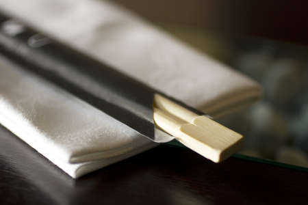 chopstick: Chopstick and napkin on a restaurant table Stock Photo