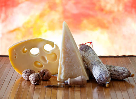 Various Cheeses nuts and italian salami  photo