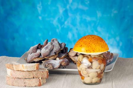 Mushrooms jar and sliced bread photo