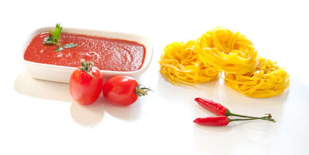 Ingredients for italian pasta on a white background photo