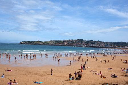 bathers: People in the beach of Gijon, Asturias - Spain Editorial