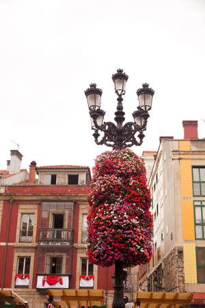 Flower decoration on a street light in Gijon, Asturias photo