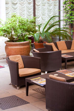 Plants, tables and chairs in a bar Stock Photo - 10004638