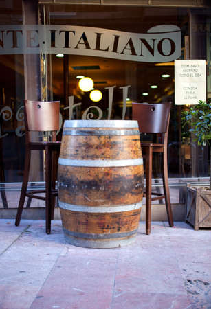 Barrel used as a table in a bar Stock Photo - 10004646