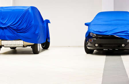Car covered by a blue sheet Stock Photo - 9936745