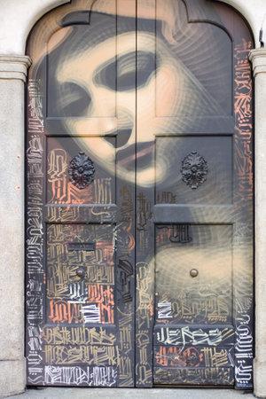 murals: Virgin Mary painted on a door