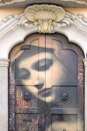 deface: Virgin Mary painted on a door