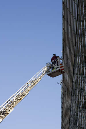 Firemans working on the crane photo