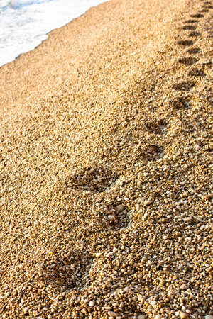 kefalonia: Footprints on the Kefalonia beach Stock Photo