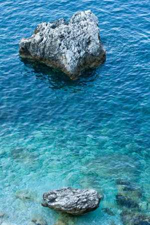 boundless: Stones in the sea, Platia Amos - Greece Stock Photo