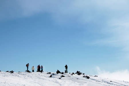 holidays vacancy: People walking on Etna Volcano covered by snow