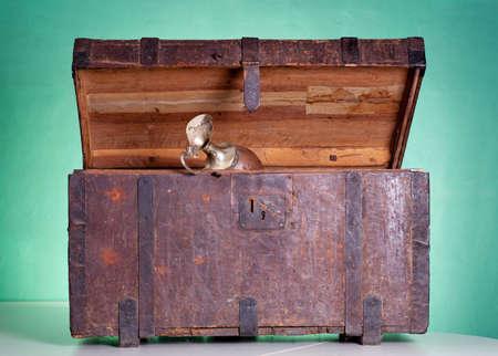 Glass pitcher inside an antique wooden trunk Stock Photo - 10098919