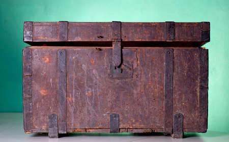 Antique wooden trunk on a table photo