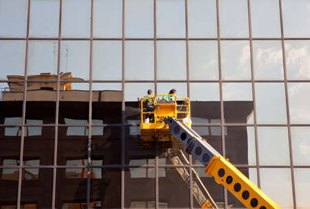 cleaning team: Men cleaning building
