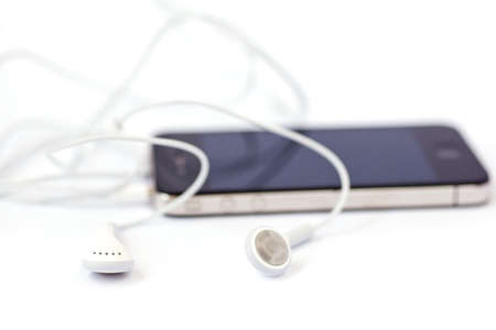 Smart phone and headphones isolated on a white background photo