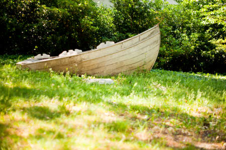 Wooden boat on grass in the park