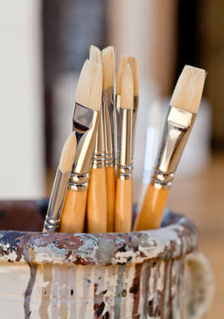 New paintbrushes in a old ceramic jar Stock Photo - 10446401