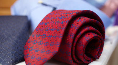buttonhole: Red necktie on a shirt