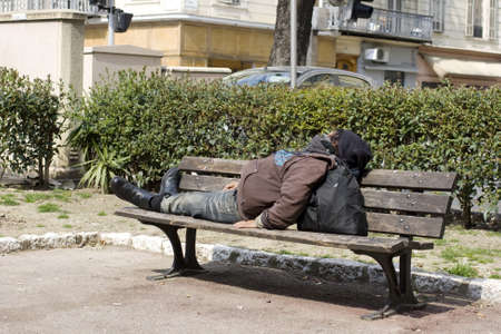 Homeless sleeping on the bench photo