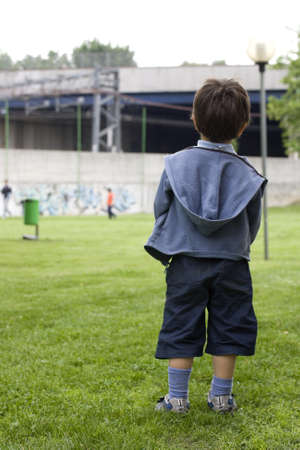 companions: Child looks at his companions to play in the park
