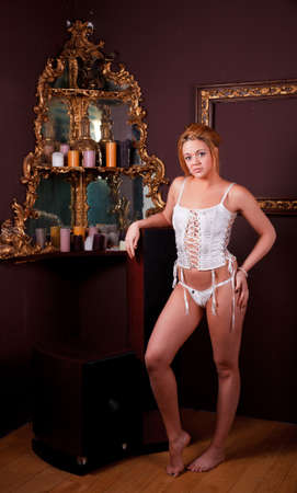 Sensual blonde girl in underwear next to a old mirror Stock Photo - 12588743