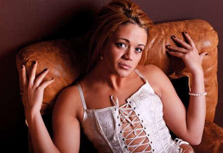 Sensual blonde girl in underwear on armchair photo