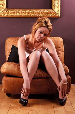 Sensual blonde girl in underwear on armchair Stock Photo - 12588953