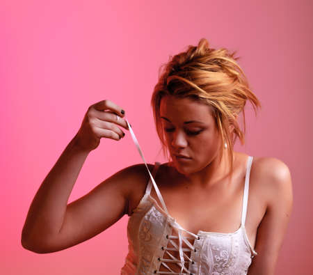 Sensual blonde girl on pink background photo