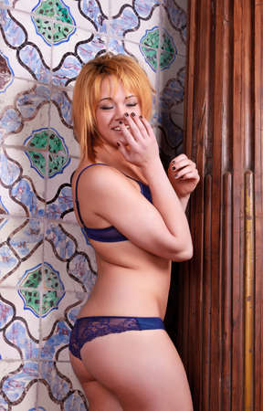 Sensual blonde girl in underwear,  old ceramic tiles background photo
