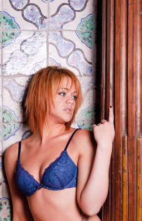 Sensual blonde girl in underwear,  old ceramic tiles background photo