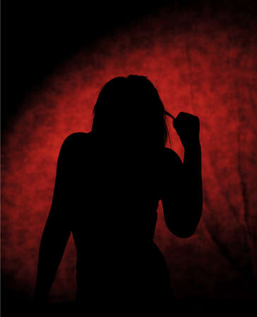 Girl silhouettes on the stool on red background photo