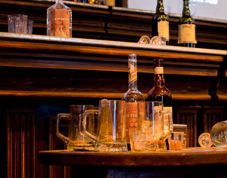 buccal: Photo of whiskey Bottles and glasses on desk Editorial