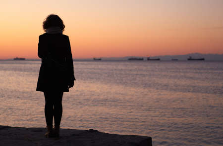 Silhouettes of a Woman that looking the sea, Trieste photo