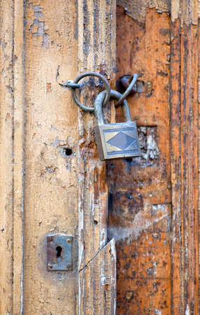 deadbolt: Photo of old wooden door closet with padlock Stock Photo