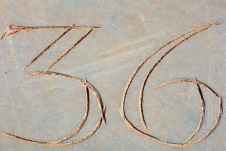 counted: Photo of Numbers etched in stone Stock Photo