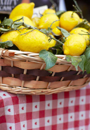Photo of Wicker basket with ripe lemons photo