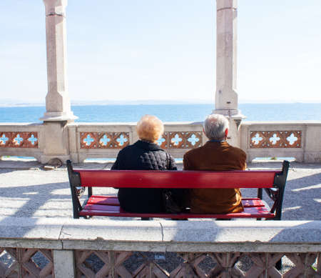 Elders sitting on a bench, Miramare castle - Trieste Stock Photo - 13544840