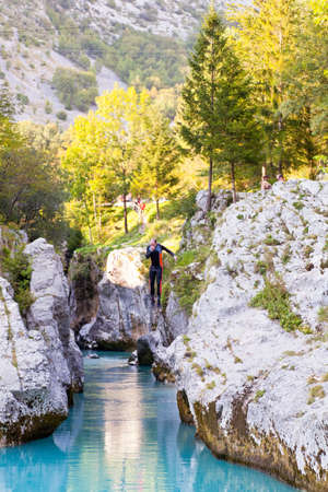 Diving in the Slovenian Soca river in the summer photo