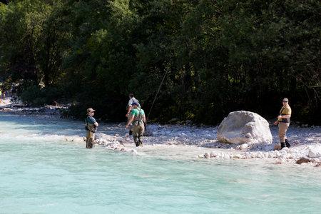 fishingpole: Photo of a Fisherman in the Soca river, Slovenia Editorial