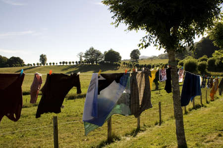 clothespeg: Laundry hanging to dry on a clothes-line Stock Photo