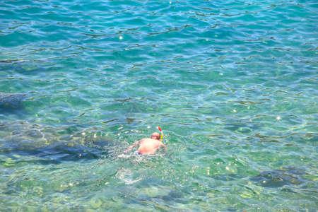 brune: Swimmer in the Baska sea Krk island in Dalmatia - Croatia