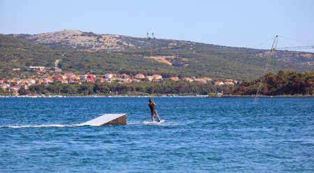 skimming:  Cable ski in the Punat sea, Krk island in Dalmatia - Croatia