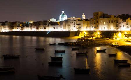 Nightview of sea and coast  Trapani, Sicily - Italy photo