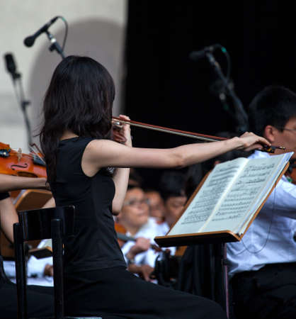 musical score: Photo of a Violinist with musical score in concert